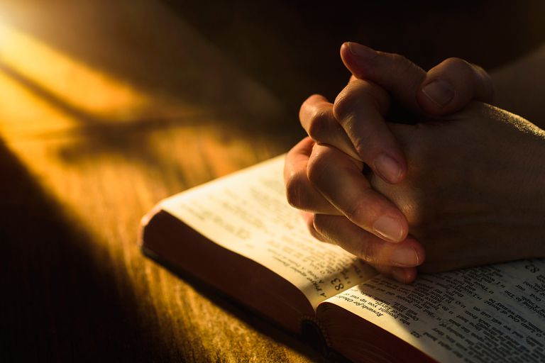 Image of praying hands and bible